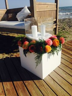 Wedding on the beach flowers ( sunset's colours)