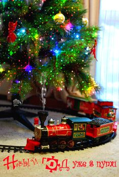 Do children still play with trains, chugging around the Christmas tree?  How I loved mine!  It didn't look fancy like this one.  It was black, a Lionel I think. The tracks  surrounded a little Christmas village. My Dad even made the houses. <3 Memories, memories....