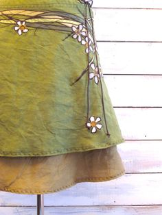 Jupe.            ~  I really like the green material's look -specifically the flowery vine print...
