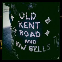 Pearly King.   Regalia. The Pearly Queen of Old Kent Road and Bow Bells.