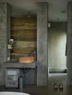 Milestone & reclaimed wood Source: Mizono chose to use Milestone in the bathroom because it's softer and more forgiving than concrete. The resin sink is lit by LED lights. The Japanese-style soaking bath is sunk into the floor. Concrete Bathroom, Concrete Wood, Bathroom Spa, Simple Bathroom, Bathroom Faucets, Bathroom Interior, Concrete Shower, Modern Bathroom, Concrete Design