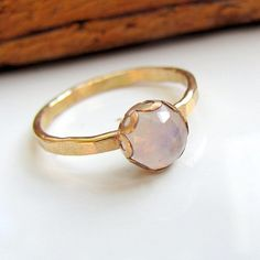 Beautiful setting, single gem, faceted, uneven band, almost perfect