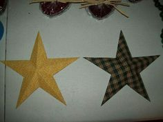 Print star on cardstock, spray unprinted side with adhesive, add fabric & let dry.  Cut out star, score, & fold.