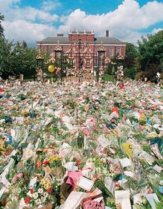 """*PRINCESS DIANA ~ Few ever could have predicted the outpouring of emotion and abject communal grief that followed in the wake of Diana's death. If there's a measurement, it might be the sea of flowers that swelled outside Kensington Palace. This photo is featured in the new LIFE book """"Diana at 50."""" (Photo credit: Mirrorpix/Everett)"""