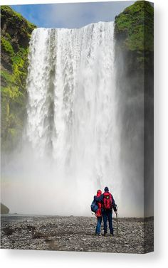 Waterfall Canvas Print for sale. Two people enjoying beautiful Skogafoss falls in Southern Iceland. The image gets printed on one of our premium canvases and then stretched on a wooden frame, click through and check out your options. 30 days money back guarantee. Matthias Hauser - Art for your Home Decor and Interior Design.