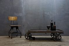 USA, c.1910s. Vintage Industrial Steel Wheeled Mooring Cart, Coffee Table, Shelf. Cast Iron Wheels and Brake, Old Growth Worn Hardwood Surface.