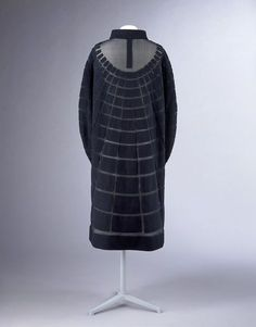 Coat | Jeanne Lanvin (1867-1946) | France, Summer 1929 | Black crêpe and silk chiffon | This coat is a significant example of the meeting between fashion and modernity: the geometrical forms, assembled according to the 'collage' technique, refer to the strong influence of abstract art on fashion during the 1920s. Black became an increasingly fashionable colour for elegant evening wear and was popularised by Coco Chanel in the mid-1920's | VA Museum, London