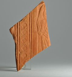 African red slip ware sherd with togatus 7