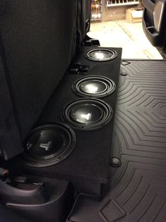 Like many of our customers, the owner of this 2019 Dodge Ram wanted to improve his mobile audio experience without sacrificing the versatility of his vehicle interior. So the team at our West Carrollton store got to work and fabricated this custom low profile subwoofer enclosure to fit underneath his crew cab's rear seat, and they loaded it with four JL Audio 10-inch subwoofers. Our team also paired it with a new SounDigital amplifier, and the combination is literally butt shaking! Custom Subwoofer Box, Subwoofer Box Design, Dodge Ram Crew Cab, West Carrollton, Ram Rebel, Jl Audio, Gmc Trucks, Audio System, Rear Seat