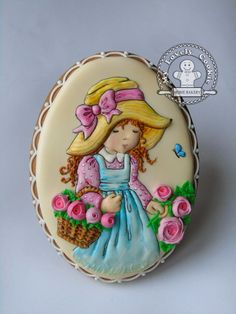 Hand painted Sarah Kay carrying basket of piped flowers. Cookie by My Lovely Cookie.  Inspired by original artwork by Vivien Kubbos.