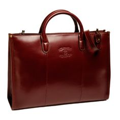 The Brenda is a briefcase designed for women with a handle and shoulder strap. Shown in a deep chestnut. Available in two sizes