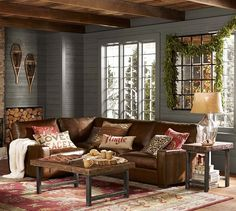 red, brown, & muted blue living room. Pottery Barn | I adore the horizontal wood paneling on the walls