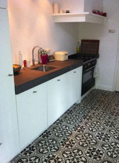 http://www.cementtiles.com/inspiration/ White kitchen with tiled floor
