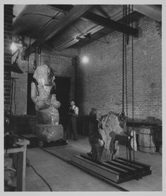 """The Metropolitan Museum of Art, Repair Shop; View of the Tank Room with a """"Large Kneeling Statue of Hatshepsut,"""" (29.3.1) undergoing treatment by C. Watts; The Tank Room was used to soak ancient sculptures. Photographed in October 1930."""