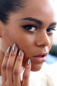 Laquan Smith - matte taupe nail contrasted with a single strip of gold foil down the center