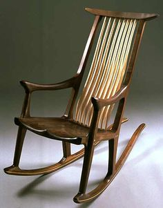 Newport Rocker by Richard Laufer. Rocking chair in walnut with a sculpted seat and cherry spindle back.
