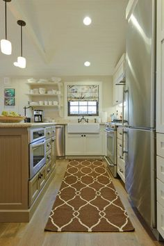 Exposed shelving & a farm sink. All I need in a kitchen!
