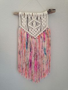 This macrame and yarn wall hanging will add a perfect pop of color to your home! The finished piece measures 12 inches wide and 23 inches long. (Hanging string adds about 4.25 inches to the length) **FREE Domestic Standard Shipping included in price** (Make sure to mark free shipping when you check out) Please message me if you would like local pick up or delivery. Thank you for visiting Nature & Knots! Make sure to follow on Instagram: @natureandknots Have a great day