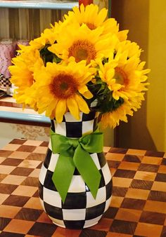 An easy happy way to make any day brighter- golden sunflowers and a MacKenzie-Childs Courtly Check Tall Vase!