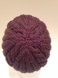 the blend of cables and ribs make this an attractive unisex hat that is relatively
