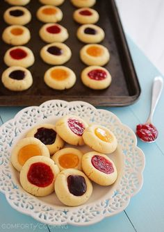 Jam Thumbprint Cookies – Buttery soft cookies with a sweet jam surprise. These simple, delicious jewel-hued cookies are amazing! | thecomfortofcooking.com