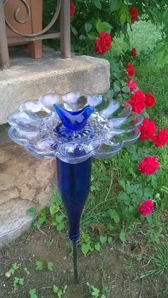 Bird bath made from a plate used for serving deviled eggs. Bird bath made f