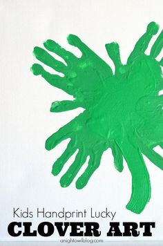 This Kids Handprint Clover Art is perfect project to take on with your kids this weekend or next - just in time for St. Patrick's Day!