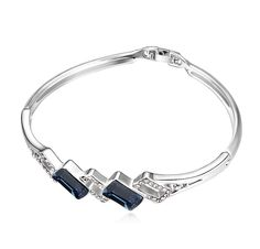 White Gold Plated Bangle with Blue CZ - Q255.00