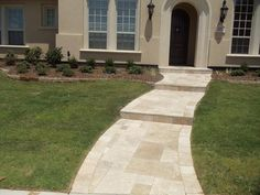 Travertine walkway installed by Precision Pavers in Plano, TX.