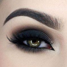Ojos ahumados en negro y chocolate. Un look sensacional.