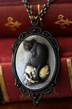 Cameo Necklace. Black Oval Cameo Cat on skull by CameoAndJuliet