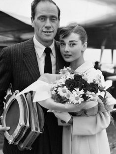 Audrey Hepburn with Mel Ferrer at the airport in Paris, 2nd June 1956.