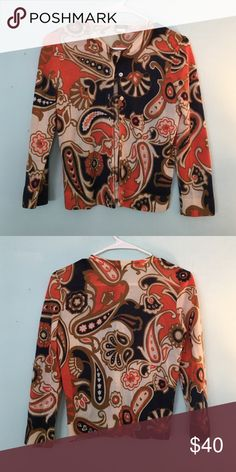 J.Crew 100% merino wool paisley cardigan Gorgeous 100% merino 3/4 length cardigan with all over orange, gold, and navy paisley print. Perfect for the office or a fancy night out, you'll be sure to turn heads in this sweet sweater! Lightly worn, lovingly cared for. J. Crew Sweaters Cardigans