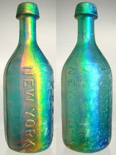 Iridescent glass patina on antique bottles - SOUTHWICK & TUPPER NEW YORK. Here's an example of Benicia glass at its best. Colors range from bright red to beautiful greens and blues – American Bottle Auctions Colored Glass Bottles, Antique Glass Bottles, Bottles And Jars, Glass Jars, Perfume Bottles, Vintage Bottles, Vintage Perfume, Vase, Bottle Art