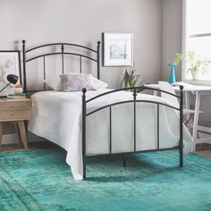 This Pogo twin-size metal bed frame makes for a stylish update to your child's bedroom decor. This frame has a modern look with a black licorice finish.