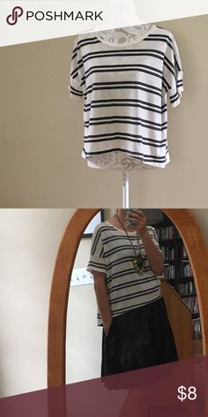 { Old Navy } black stripe boxy tshirt Comfy cream tshirt with black stripe. Boxy, relaxed fit, very versatile. I throw these on over sundresses to take my summer wardrobe into fall (I posted a picture to show what I mean). I have so many so I'm letting a few go. Gently worn. Tag says XS but run big, will fit size S and M as well. Slightly longer in the back. Old Navy Tops Tees - Short Sleeve