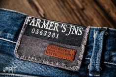 Screen printed fabric with hot printed leather label made in Italy by Panama… Leather Jeans, Denim Jeans Men, Garra, Clothing Store Design, Boutique Logo, Leather Label, Fashion Tag, Denim Branding, Label Design