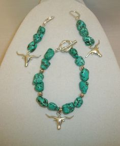 Bracelet & earring set... Turquoise w/silver spacer beads & Longhorn charms...