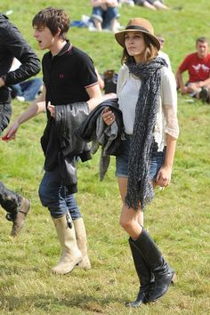 August 28 2008 In a scarf, fedora, denim shorts, vintage boots and a silk blouse at the Leeds Festival.