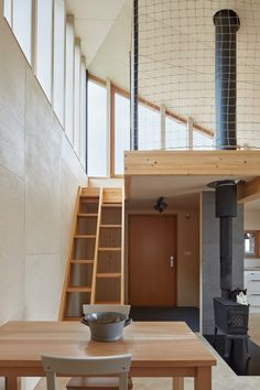 Image 10 of 29 from gallery of Chestnut House / Valarch Studio. Photograph by Jakub Skokan, Martin Tůma / BoysPlayNice 3 Living Rooms, Living Spaces, Garage Design, House Design, Mezzanine Loft, Closet Built Ins, Brown House, Sleeping Loft, Small Studio