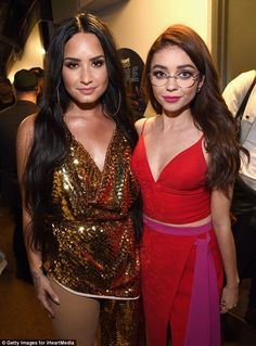 Screen stars: Demi also posed with Modern Family star Sarah Hyland, who was again rocking her chic oversized glasses