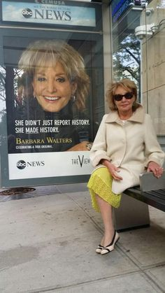 Barbara Walters at a bus stop, with her ad.