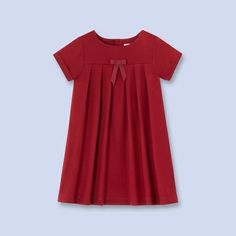 Gorgeous holiday wear on sale at Jacadi: Bow trimmed empire girls dress.