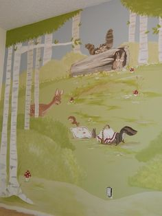 A sweet hand painted woodland mural in a little girls room