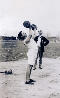 """Perikles Kakousis was a Greek weightlifter who won gold in the two-hand lift at the 1904 Olympics in St. Louis. He was heralded in the local press for coming """"thousands of miles to carry modern Olympic honors back to his native land."""""""