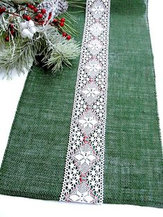 Lovely, rustic Holliday decor with this Christmas table runner made of green burlap with a beautiful Christmas style white, red and green hand crouched vintage inspired lace, displayed on the center.  All the edges are machine stitched, and will not fray.    The size is 12x 72  Customizable in size.  At your request, I can custom make matching place mats ,as well.    Please contact me before you purchase if you need a different size or color(red or natural burlap available).    Thank you for…