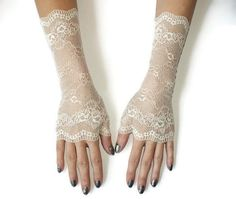 Ivory lace gloves/Wedding long gloves/Bridal lace gloves/Fingerless Gloves by JuliannaFashion on Etsy https://www.etsy.com/listing/254210986/ivory-lace-gloveswedding-long