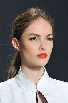 Top Makeup Trends for Spring / Summer 2014 - http://www.hairstylemakeup.com/top-makeup-trends-spring-summer-2014.php http://www.hairstylemakeup.com/wp-content/uploads/2014/03/makeup-trends-orange-lips-by-dennis-basso-679x1024.jpg