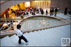 Ring Bearer making his way down the Marble Staircase at The City Club of Washington