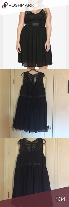 NWT Torrid party dress NWT Torrid Party dress.  Black lace with chiffon and ribbon detail at waist.  Has back zipper and is fully lined from chest to hem. torrid Dresses
